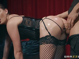 Cutie in black fishnets combines bootie increased by cunt fucking