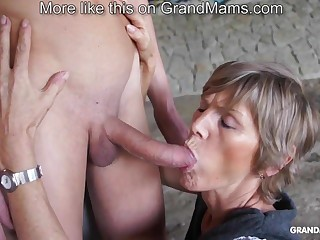 Horny old cougar tapes upon her young toyboy and sucks him not present