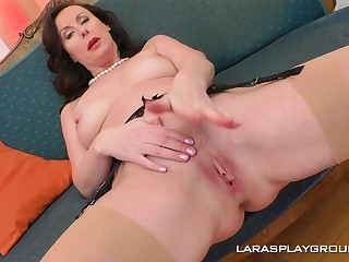 Mature glamorous brunette Lara strips and fingers herself