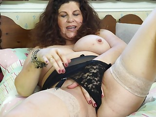 Amateur brunette mature granny Gilly strips at home
