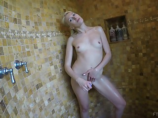 Blue eyed beauteous Angelina masturbates in the shower