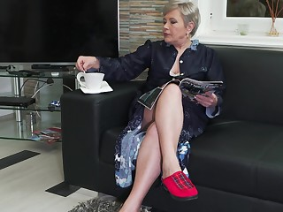 Amateur short haired mature granny Klaudia D. masturbates
