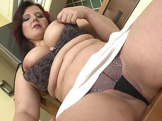 Pessimistic BBW Riona moans while she plays with a stiff dildo