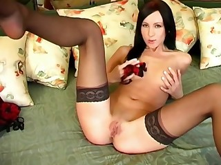 Isabell stuffs a vibrator concerning their way tight pink pussy.