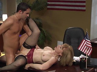Nina Hartley gets her pussy pleased by horny ladies' on the desk