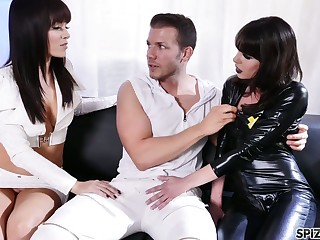 Two sex-starved bitches beside latex outfits are fucked hard by hot blooded dude