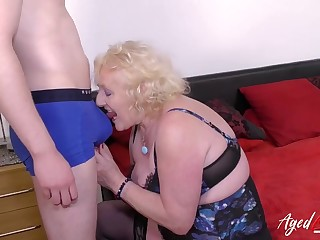 Grandma strips a young guy to play fro him