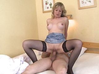 Blonde woman rides man's cock and waits 'til he cums on her