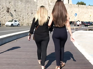 Greeks round beautiful asses for a walk