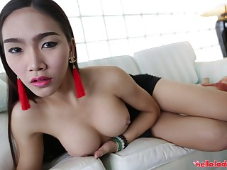 Thai ladyboy with big tits fucks an American tourist in the hotel room