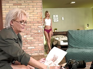 Sexy GILF photographer having sex involving a handsome young woman