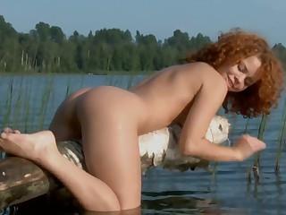 Outdoors video be fitting of cute redhead Avina Netu pleasuring will not hear of pussy